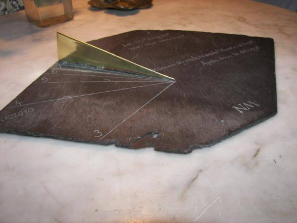 slate and brass sundial